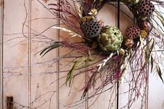 Artichoke and Lotus Wreath Natural Decor by TheLinnetsWing Overview Handmade item Size: 8-inch ring Materials: birch branches, dried artichokes, dried oats, dried caspia, dried love in a mist, dried grasses, dried lotus pods, ribbon