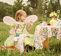 Bubbles, doll, wings, flowers. My kind of tea party! :-)
