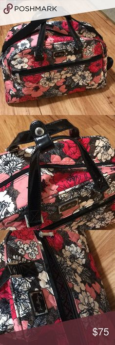 Vera Bradley Weekender Bag Used once Weekender bag, two inside mesh pockets, one inside zippered pocket, one outside zippered pocket and outside suitcase strap. Also includes never opened luggage lock. In brand new condition! Vera Bradley Bags Travel Bags
