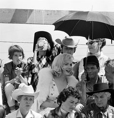"""Marilyn Monroe with Eli Wallach and director John Huston on the set of """"The Misfits"""", 1960."""