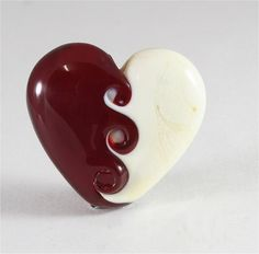 Handmade Lampwork Bead Heart Ivory Red LE Team DUST Team SRA. $22.00, via Etsy.