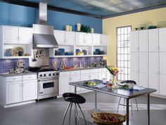 Bold, bright and futuristic, this kitchen features WOLF Designer Cabinets.
