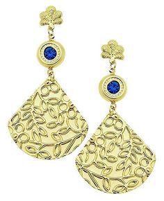Brinco folheado a ouro, contendo estampas de flores e pedra de strass. - See more at: http://www.imagemfolheados.com.br/detalhes_prod.asp?origem=Vitrine&CodOrigem=1&id=5667&a=86684#sthash.lY9DNrai.dpuf