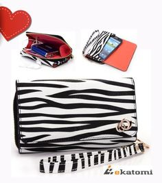 On-the-go Travel Wristlet Wallet Clutch Lady Bag for HTC EVO 4G LTE - Black & White Zebra Animal Print. Bonus Ekatomi screen cleaner by Kroo. $29.99. Bonus reusable sticker, Ekatomi screen cleaner.   Suitable for a woman for whom both fashion as well as price is important!   This new wallet style wristlet pouch does double duty to protect and hold your pocket belongings in one secure location. *May use with case/shell on your phone for additional protection*   Wall...