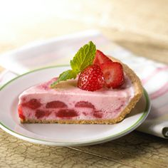 Strawberries folded into a mixture of sweetened cream cheese and sour cream give this pie a beautiful pink color and a powerful berry flavor.