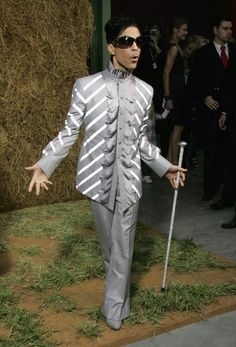 Prince decked out in gray with walking stick