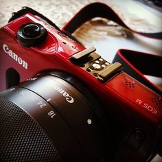 The Canon EOS M mirrorless in red.