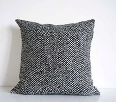 Decorative pillow in a chunky black and white herringbone weave, sourced from Italian fashion house Max Mara. I was lucky enough to get the end of a