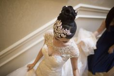 The bride is in a beautiful, elegant wedding dress. Wedding Planning by Elegant Aura, elegantaura.com, Photography by Hitched Studios. Click to see more beautiful wedding photos!