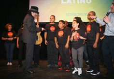 "Musician Carlos Santana accepts a guitar signed by 300 students of the Little Kids Rock program funded by his Milagros Foundation during the HBO Latino NYC Premiere of ""Santana: De Corazon"". (Photo by Jerritt Clark/Getty Images for HBO Latino)"