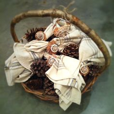 branch handled gift basket from Heather ross [ in house ] with handwoven cotton napkins, seashell napkin rings & large pine cones