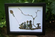 Family of Five with their dog. Pebble art by www.saltandpebbles.com