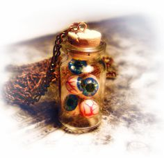 Eyeballs in a bottle necklace, creepy, weird, horror, psychobilly jewelry. €30.00, via Etsy.