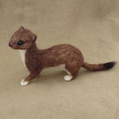 Needle felted brown weasel   A life-sized, completely pose-able needle felted weasel or stoat, as some call them. Hes made with wool from my sheep and felted over a wire armature. About 8 inches long and 1.5 inches high at the shoulder! He also has little horse hair whiskers. This felt is unique from my others because he is made with glass eyes.  *** This item is MADE TO ORDER and due to high demand the wait is approx. 6 months. Thank you all for your patience!  Because of the long wait…