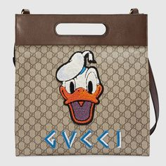 1871712a730 Gucci featured Donald Duck on a line dedicated to him. This crossbody is