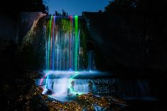 Surreal long exposures taken with glow sticks in waterfalls. Photographers Sean Lenz and Kristoffer Abildgaard. The series is entitled Neon Luminance. From the Lenz website: http://www.fromthelenz.com/