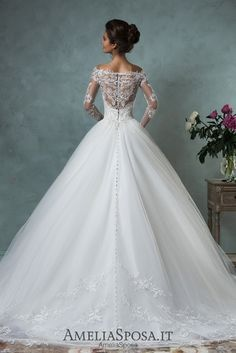Wedding dress Nova - AmeliaSposa.  A classic silhouette that spreads femininity and generousness. A light skirt makes the whole look luxury and royal. A little bit soft sleeves and a transparent back embroidered by lace will emphasize your sensuality and make a fiancé's heart beat thick.