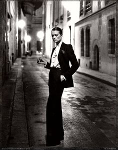 Helmut Newton phptp of Yves Saint Laurent Le Smoking Jacket
