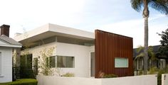 Modern exterior by TPA Architecture. It looks like wood but it is actually a rusted color metal.