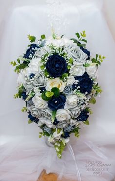 Navy, ivory , silver/grey artificial teardrop bridal bouquet. I made for my daughter.