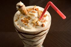 Drumstick Milk Shake - Vanilla ice cream, peanuts, and hot fudge blended with a crushed sugar cone.