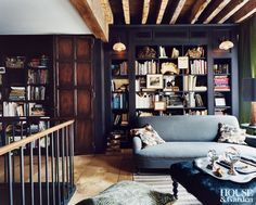 The library in photographer Carter Smith's Manhattan home is full of repositioned treasures. #HouseandGarden
