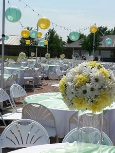 Lesch Ampitheatre-Oshkosh Mint & Yellow wedding Carnations & daisies Overhead lighting