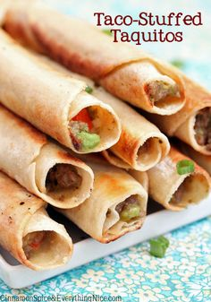Taco-Stuffed Taquitos :: 1 lb ground beef 1 onion, diced 2 garlic, minced 1 packet of taco season 1 + 1/2 c cheddar 1/2 c avocado, diced  3/4 c salsa or cut tomatoes 1/2 c sour cream  oil, for pan-frying corn or flour tortillas  sour cream, salsa and/or guacamole to serve Make taco meat, mix in the rest, warm corn tortillas in microwave then fill, roll. Pan fry or bake @ty fornes for 13-15 min.