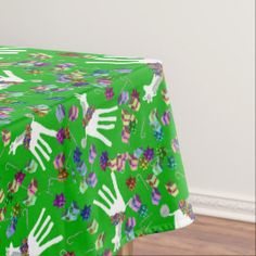 Frond the Giraffe is the star of this festive Christmas tablecloth   Frond the Giraffe. Copyright Shari P Kantor Creative Universe SPKCreative LLC. All Rights Reserved.