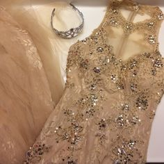 Nude sequined halter neck mermaid prom dress Nude color dress that was worn ONCE for a class period as a PROM expo. Not even worn to prom. Great condition. Bottom is laced and flowy. Neck area is sheer. And it's very beautiful. got a lot of comments on it !:) not Sherri hill Sherri Hill Dresses