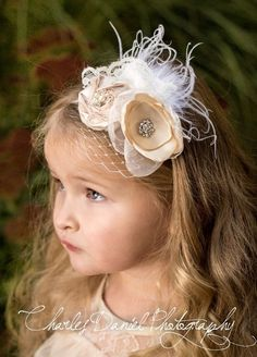 Beautiful little flower girl headband with ostrich feathers, cream colored flowers and Crystal accents...