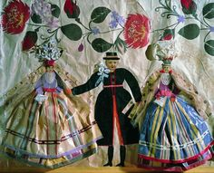 This truly delightful paper collage is from Poland, and was created in the early 1930's.  It shows a bridal couple and bridesmaid.  Researching the folk costume reveals that it is from Warsaw.  How wonderful that the artist used photos for the faces, along with printed papers for the clothing.  I adore the flowers around the couple as much as the costumes.     Via Den Store Danske