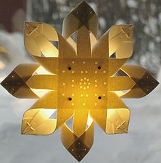 Advent Star in retro style. The star is made of  wool (100%), lamp shade plastic and metal parts http://www.ateljenord.com