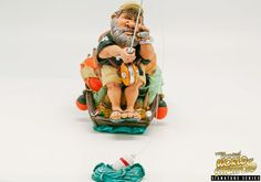 This is a Fisherman collectible figurine. It is the perfect gift for Fathers Day, retirement, birthday or event. Warren Stratford http://www.warren-stratford.com/who-is-warren-stratford/  is the master of the collectible figurine.  Warren Stratford www.warren-stratford.com is the world's most loved comic artist. His collectible figurines are sold in the best retail and online shops in the world.