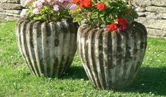 """A pair of well weathered composition-stone urns of ribbed ovoid form with good internal planting depth.  20th Century  18"""" dia x 21"""" high  £360 for the pair"""