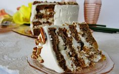 This cake is made with moist banana and pineapple cake, spiced with cinnamon, studded with pecans, and topped off with cream cheese frosting,