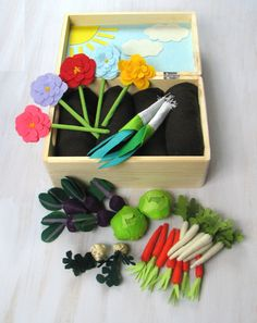 Sunny Felt Fabric Vegetable Garden Play Set  This big set of vegetables (7 carrots, 6 parsnips, 2 leeks, 2 celeriacs, 5 beets, 2 heads of lettuce) and 5 flowers made of felt and fabric, together with a vegetable patch will please both girls and boys! They will drill, care of seedlings and then have a good crop and use it in the kitchen. This vegetable patch is in playwood box. There is a picture on the inside part of cover - it is made of felt and it presents sunny sky.  Vegetables and…