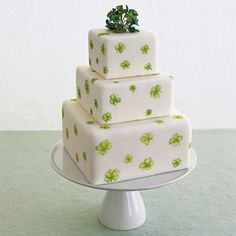 St. Patrick's Day  Celebrate your good luck by serving this Banbury-rose cake filled with lemon buttercream, covered with rolled fondant, and decorated with sugarpaste four-leaf clovers. Serves 44, $385, by Jan Kish for La Petite Fleur. Cake stand from Pottery Barn