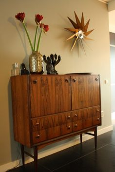 The perennial favorite turbine clock by George Nelson and that gorgeous  Palisander wood bar cabinet.