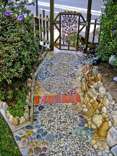 Beautiful mosaic path made from assorted stones, bricks, and pavers.