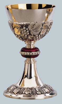 "This beautiful chalice has a repousse vine and leaf motif around the cup and base. Delicately hand chased the chalice measures 7-3/4"" high, has a cup 4-1/2"" in diameter with a capacity of 14 oz. The node is enameled in red with a beaded ring. The cup and 6-1/4"" diameter dish paten are gold lined. Made in brass, silverplated the cost is $3,355.00. Please let us quote prices for construction in all sterling silver or construction with a sterling silver cup…"