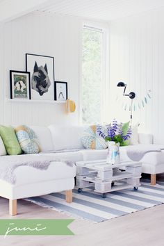 Love this white & bright living room. Perfect for people who tired of color quickly. By having a white or neutral foundation, you can add small pieces with a pop of color & change them each season!