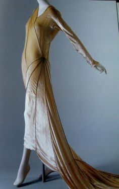 Madeleine Vionnet. This gown is quite avant-garde. It's hard to believe it's from the thirties.