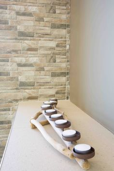 Earthy tones are perfect for an #outdoor area. A textured tiled #wall contrasts against a smooth painted wall