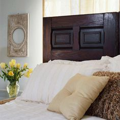 A door from an architectural salvage makes a shabby-chic headboard.