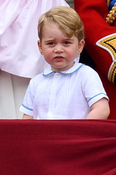 Prince George Photos - Prince George of Cambridge watches a fly past during the Trooping the Colour, this year marking the Queen's 90th birthday at The Mall on June 11, 2016 in London, England. The ceremony is Queen Elizabeth II's annual birthday parade and dates back to the time of Charles II in the 17th Century when the Colours of a regiment were used as a rallying point in battle. - Trooping the Colour 2016
