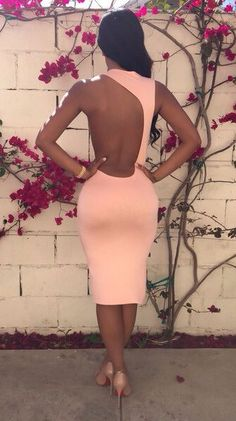 love the open back. makes this simple dress eye catching #streetstyle