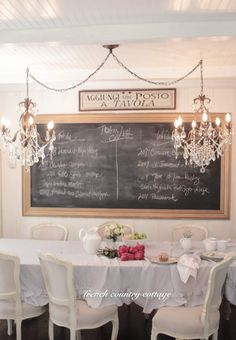 Love the French Country shabby chic look of this dining room. The twin chandeliers and vintage chalk board are yummy too.