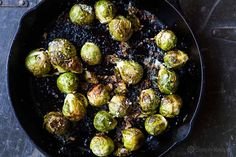 The BEST way to cook brussels sprouts? ROASTED! Like popcorn, they're so addictive. With garlic, olive oil, lemon juice, salt, and Parmesan. On SimplyRecipes.com #BrusselsSprouts
