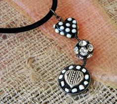 Happy Valentine's Heart Mosaic Necklace!  An easy DIY jewelry project from www.rings-things.com.  Leather choker, black and white lampwork heart bead, black and crystal rhinestone ball, and a small mosaic made using EnCapture Artisan Concrete, some white trade beads and a decorative metal heart bead.